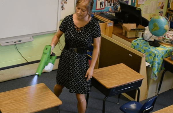 Victory Innovations - Sanitation Application - Handheld Sprayer being used to clean classroom desks